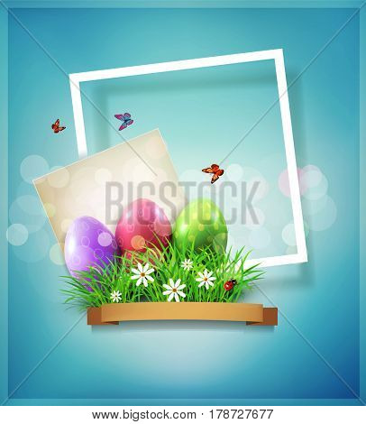 Easter eggs in green grass with white flowers, butterflies, vintage card for congratulation and frame on a blue background. Vintage element for design.