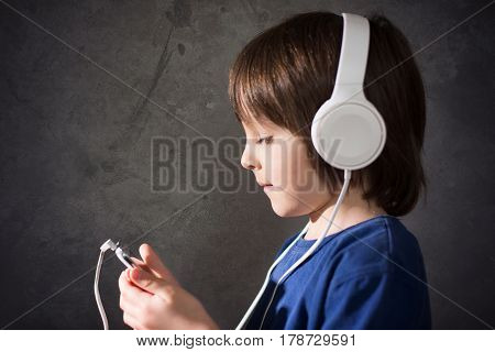 Cute Boy With Phone And Head Phones, Listening Music