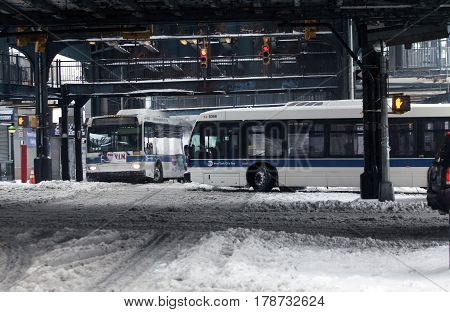 BRONX NEW YORK - MARCH 14: MTA buses ride during snow storm. Taken March 14 2017 in New York.