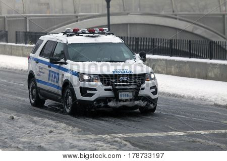 BRONX NEW YORK - MARCH 14: Police vehicle patrols during snow storm. Taken March 14 2017 in New York.