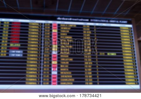 abstract blurred image of flight information board at the airport transportation concept.