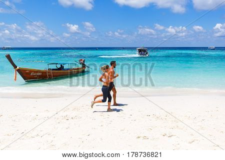 Koh Lipe at satul Thailand - 21 March 2017: Visitors the tourist jogging on the beautiful Andaman Sea beach Healthy exercise concept.
