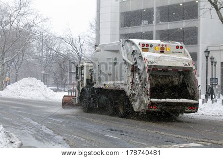 BRONX NEW YORK - MARCH 14: Sanitation trucks plowing snow in the Bronx. Taken March 14 2017 in New York.