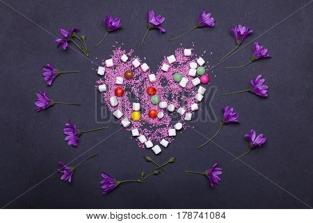 Colorful Dragee Sweets, Marshmallow, Flowers And Sprinkles In Heart Shape
