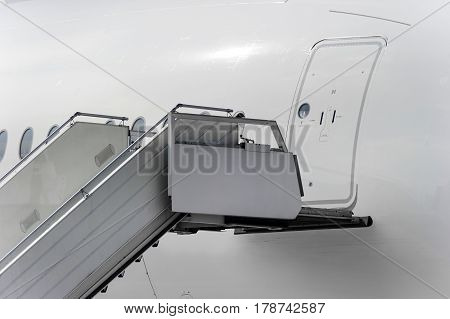 Ramp near entrance in passenger plane, mobile ladder in airport, aviation and aerospace industry, detail