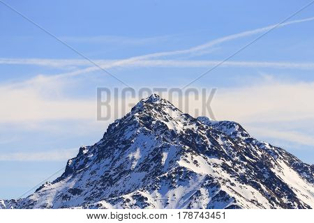 The mountaintop of the Ultner Hochwart in the Ortler Alps in South Tyrol seen from Schwemmalm summit station.