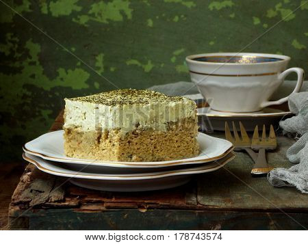 Green Three Milk Cake With Japanese Tea Matcha On Wooden Background. Traditional Dessert Of Latin Am