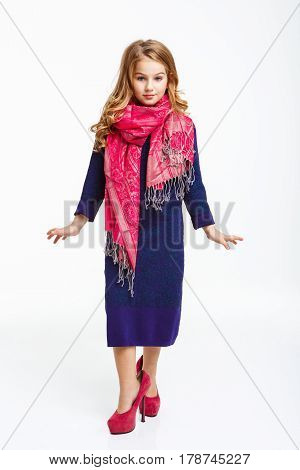 Charming little lady in sleeve midi dress , pink scarf, pink heels shoes. Model pose.