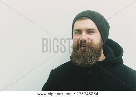 Bearded Happy Brutal Caucasian Man In Black Jacket And Hat