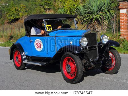 Mignanego Italy - September 25th 2015 - Reenactment 18th Pontedecimo Giovi: The Fiat 504 Spider 1930 conducted by Giorgio Poli during a timed regularity 'test.