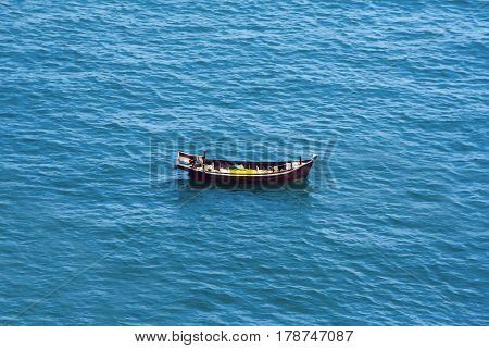 Chinese boat a villager  in the sea without people. Wooden ship lonely and empty.
