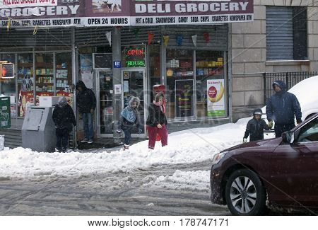 BRONX NEW YORK - MARCH 14: People near grocery store manage snow storm. Taken March 14 2017 in New York.
