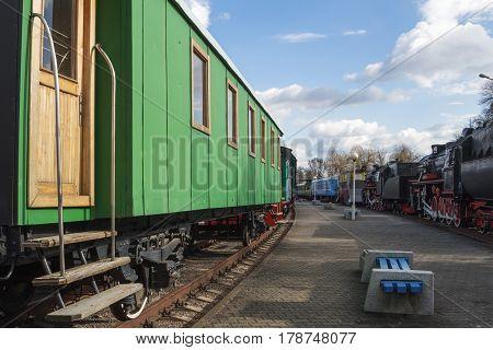 Оld railway passenger car at the station.