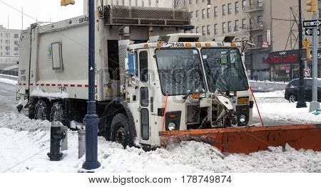 BRONX NEW YORK - MARCH 14: Sanitation truck parked in snow. Taken March 14 2017 in New York.