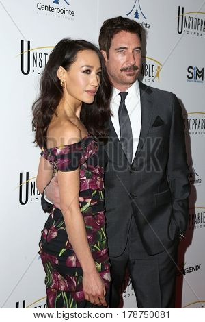 LOS ANGELES - MAR 25:  Maggie Q, Dylan McDermott at the Unstoppable Foundation Gala at the Beverly Hilton Hotel on March 25, 2017 in Beverly Hills, CA