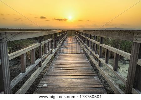 Wooden bridge with sunset sky in twilight at Sam Roi Yot National ParkThailand