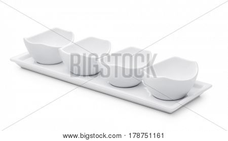 Empty sauce and condiment dip bowl set isolated on white
