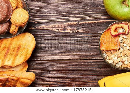 Bread, banana and muesli. Battle for healthy lifestyle.