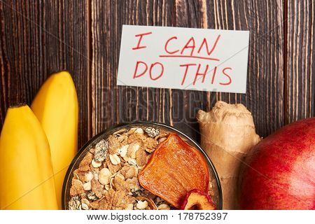 Fruits, muesli and motivation card. Healthy choice changes life.