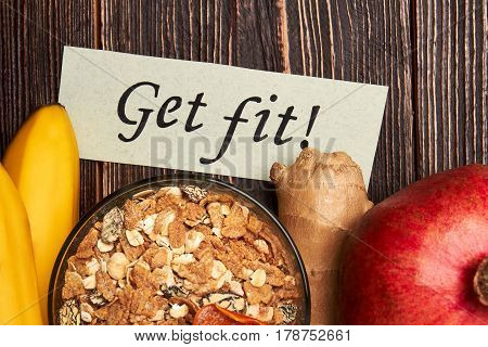 Muesli, bananas and motivation card. Health and good mood.