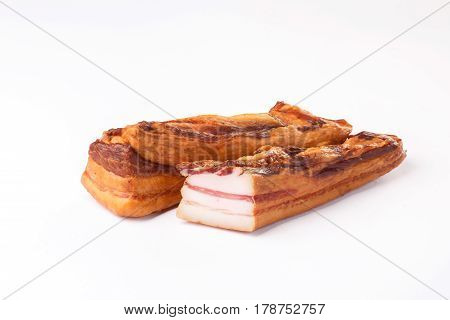lard on a white background. pork is in spices. layer of meat