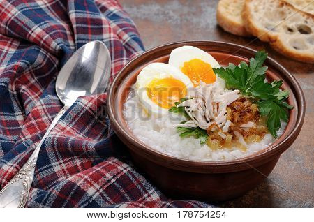 Rice porridge ginger congee with egg chicken crispy shallots and parsley