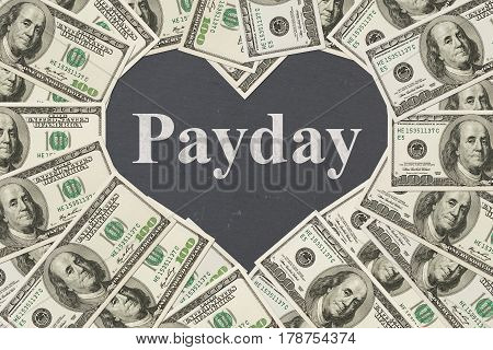 The love payday message One hundred dollar bill in the shape of a heart with a chalkboard heart with text Payday