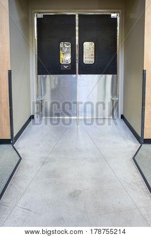 Illuminated modern black door with aluminum in store