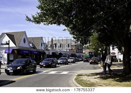 Falmouth, Cape Cod, Massachusetts- September 13, 2014 -- Wide view of Main Street in Falmouth, Cape Cod, Massachusetts with shops and people walking on the street on a bright and sunny day in mid September.