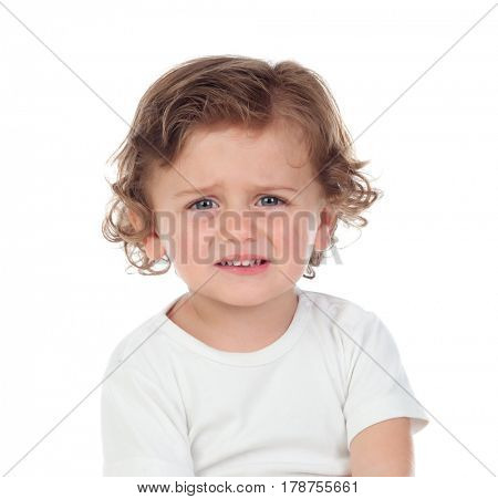 Sad baby looking at camera isolated on a white background