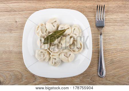 Boiled Dumplings With Bay Leaf In Plate, Fork