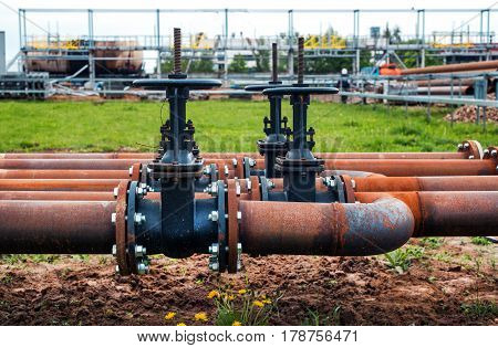 steel pipes with valves on industrial enterprise