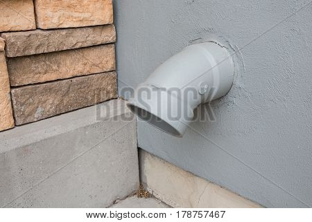 outdoor old rainwater pipe on grey wall
