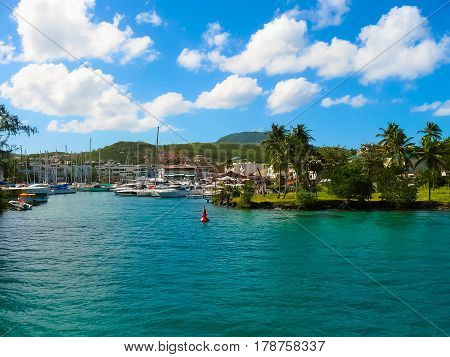 Small Yachts and boats and many buildings on the coast of Martinique, Fort de France at French Caribbean island