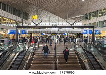 Rotterdam The Netherlands - March 10 2017: Interior of modern railway station by architect MVSA in Rotterdam with escalator stairs and travelers in the Netherlands.