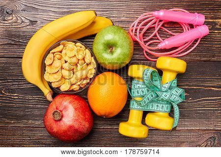 Skipping rope, dumbbells and fruit. Formula of health.