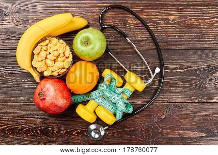 Stethoscope, dumbbells and measuring tape. Developing love to healthy life.