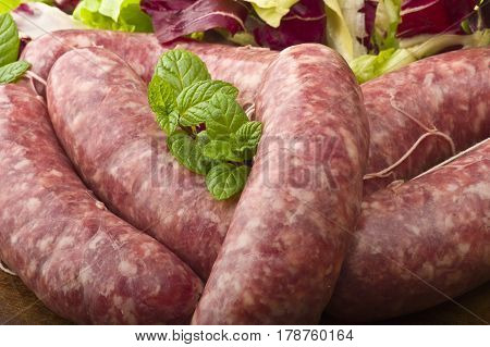 raw homemade sausage on a wooden board