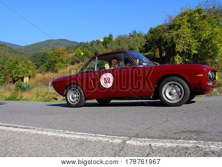 Mignanego Italy - September 25th 2015 - Reenactment 18th Pontedecimo Giovi: The Lancia Fulvia 1300's conducted by Frola-Cantatore during a timed regularity 'test.