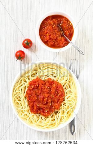 Traditional Italian Spaghetti alla Marinara (spaghetti with tomato sauce) in bowl photographed overhead with natural light