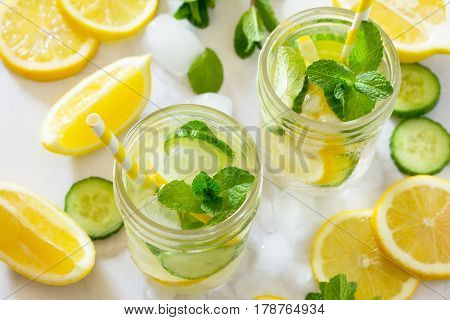 Refreshing Summer Drink With Lemon And Cucumber On A Background Of Stone. The Concept Of Eating Vege