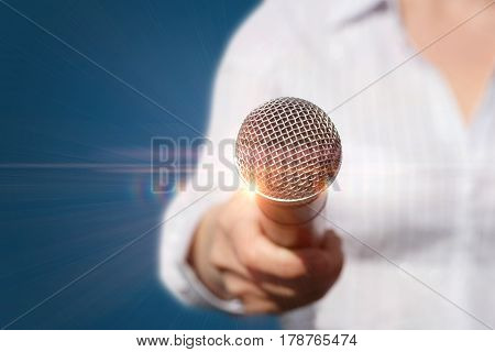 Female with microphone on blue background .