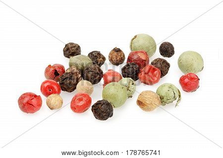 macro of mixed peppercorns isolated on white