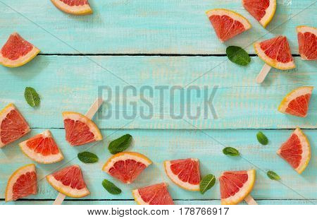Slices Of Red Grapefruit Popsicle On A Vintage Wooden Background, Copy Space. The Concept Of A Healt