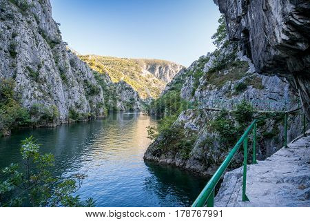 View of beautiful tourist attraction, lake at Matka Canyon in the Skopje surroundings, Macedonia. Hiking trail along side the mountain. poster
