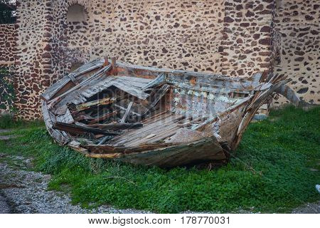 Image of old boat near the ancient wall Oia Santorini Greece