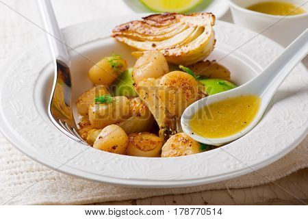 Grilled Scallops with Fennel and Lime Butter. selective focus