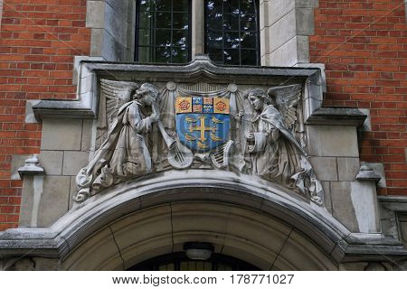 LONDON, GREAT BRITAIN - SEPTEMBER 7, 2014: This is an ornamental decoration with the coat of arms of St. Edward over the entrance to Westminster Abbey Choir School.