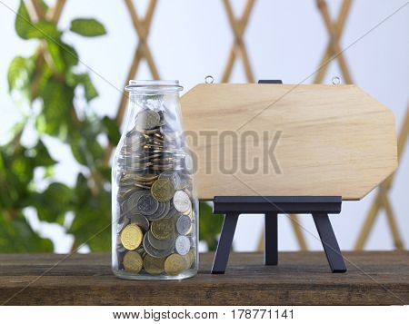 saving jar and an easel with blank plank for copy