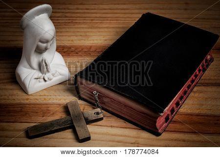 Virgin Mary bible cross on wood, dark